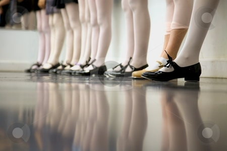 Tap Dance Class stock photo, Young tap dancer... low angle shot of just feet and legs by Mitch Aunger