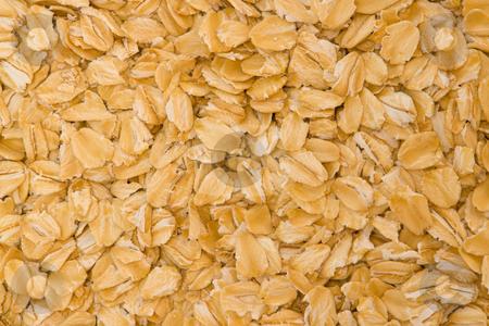Haferflocken stock photo, Haferflocken sind ein Grundnahrungsmittel, das aus Saat-Hafer hergestellt wird. Sie beinhalten einen hohen Anteil an Eiwei?, einen hohen Gehalt an unges?ttigten Fetts?uren, den Schleimstoff Lichenin, Vitamin B1, B6 und E, Eisen und Calcium by Wolfgang Heidasch