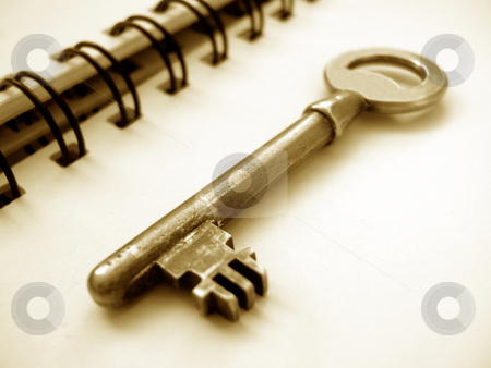 Key on a notebook stock photo,  by Gautier Willaume