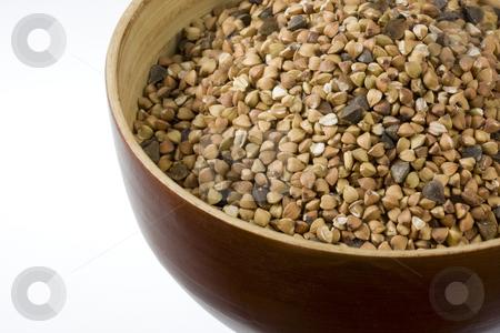 Buckwheat (kasha), toasted whole grain stock photo, A wooden bowl of buckwheat (kasha), toasted whole grain, white copy space by Marek Uliasz