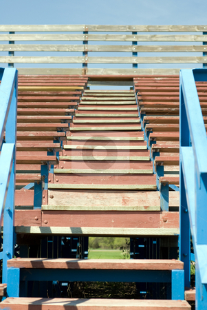 School Bleachers stock photo, A low angle view of a set of stairs climbing up some school bleachers by Richard Nelson