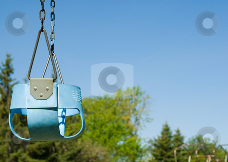 Blue Infant Swing stock photo, Low angle view of a blue infant swing shot on a sunny day by Richard Nelson