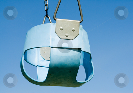 Blue Baby Swing stock photo, Low angle view of a blue baby swing shot against a cloudless sky by Richard Nelson