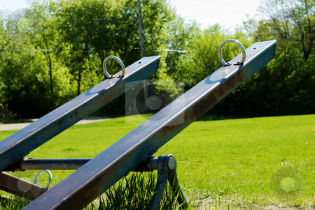 Teeter Totter stock photo, Two teeter totters saturated with color, shot in a playground by Richard Nelson
