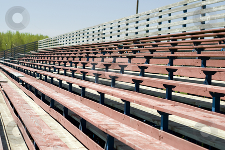 Wooden Benches stock photo, An empty set of school benches, used for watching sporting events by Richard Nelson