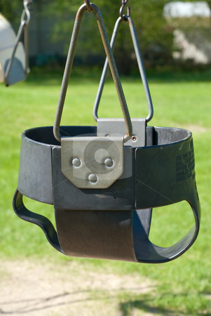 Baby Swing stock photo, Close-up of a baby swing in the playground by Richard Nelson