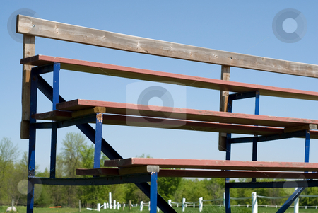Bleachers stock photo, Low angle view of a set of school bleachers, shot against a blue sky by Richard Nelson
