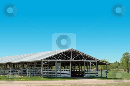 Cattle Barn stock photo, A hollowed out cattle barn, shot on a clear sunny day by Richard Nelson