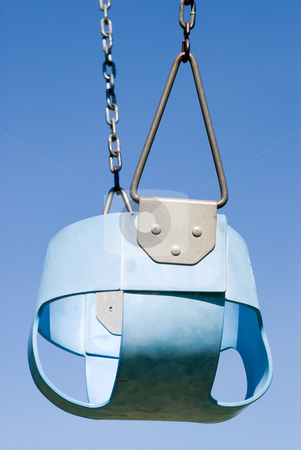 Baby Swing stock photo, Low angle view of a blue baby swing shot against a cloudless sky by Richard Nelson