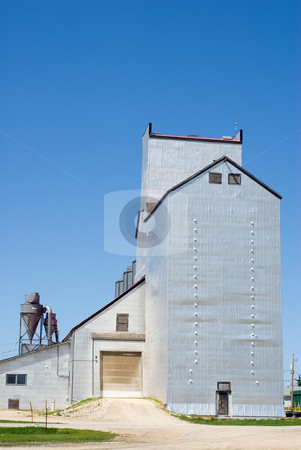 Grain Elevator stock photo, A large grain elevator shot against a blue sky by Richard Nelson