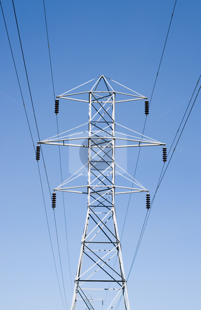 Utility Line stock photo, Low angle view of a giant utility line, shot against a blue sky by Richard Nelson