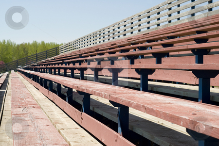 School Bleachers stock photo, Multiple levels of wooden bleachers used for watching sporting events by Richard Nelson