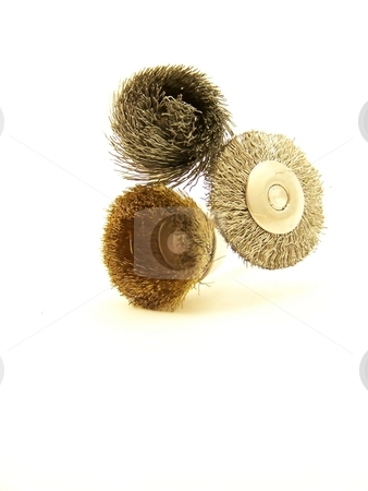 Three Drill Accessories, Vertical stock photo, Image of three drill accessories with wire bristles, arranged vertically. by Jill Oliver