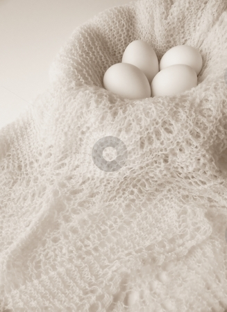 Eggs and Crochet, Black and White Vertical stock photo, Image of four white eggs sitting in a bowl covered with a finely crocheted shawl.  Black and white with vertical orientation. by Jill Oliver