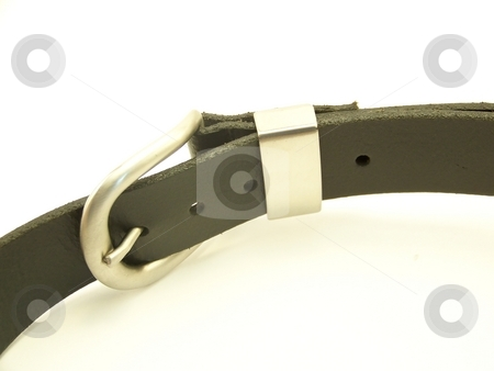 Black Leather Belt, Horizontal stock photo, Image of a black leather belt with metal buckle, laying on its side and curving through the frame.  Horizontal orientation. by Jill Oliver
