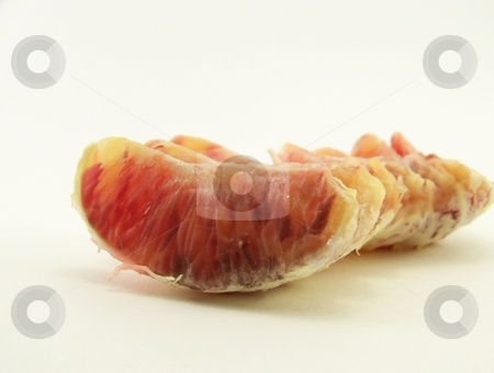 Blood Oranges stock photo, Image of a peeled blood orange, segments lined up in a row.  Horizontal orientation. by Jill Oliver