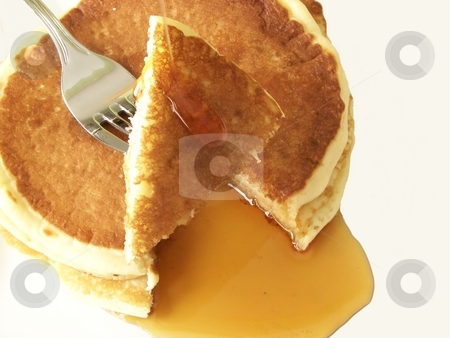 Pancakes 5 stock photo, Image of two sliced pancakes and metal fork, with a stream of maple syrup. by Jill Oliver