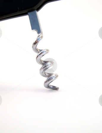 Corkscrew Detail, vertical stock photo, Detailed image of a metal corkscrew with black handle, entering the frame from the top.  Vertical orientation. by Jill Oliver