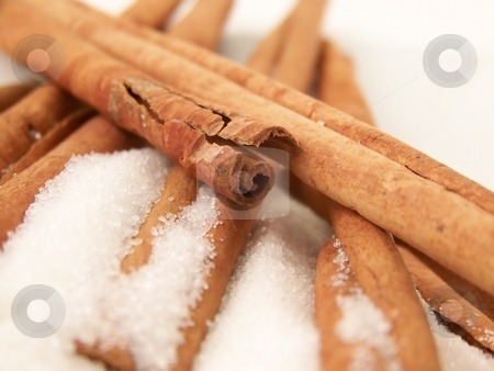 Cinnamon Sticks and Sugar stock photo, Image of cinnamon sticks piled in white granulated sugar. by Jill Oliver