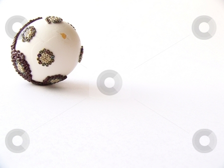 Decorated white egg stock photo, Image of a white egg decorated with gold, green, and red beads, with cracked shell. by Jill Oliver