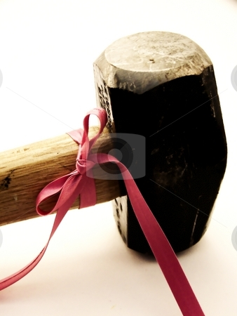 Two Pound Sledge with Pink Bow stock photo, Image of a black two pound sledge with a thin bright pink ribbon tied in a bow and moving away toward the edges of the image. by Jill Oliver