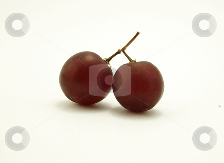 Red Grapes that look Like Cherries, Centered stock photo, Close up image of two red grapes joined together, resembling cherries, centered in frame.  White background and horizontal orientation. by Jill Oliver