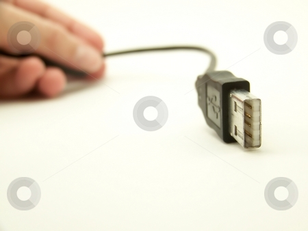 USB Cable with Hand, 1 stock photo, Image of a curved USB cable, with hand in background of image.  Horizontal orientation. by Jill Oliver