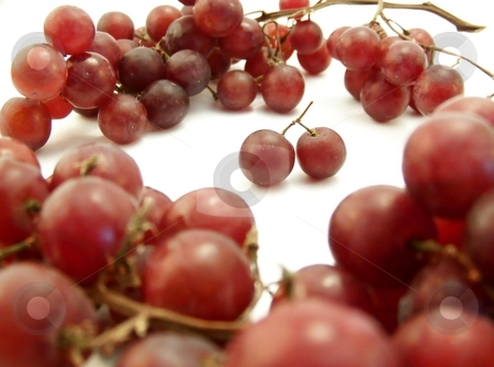 Red Grape Ring on White, Horizontal stock photo, Image of red grapes forming a ring around two joined together.  White background.  Horizontal orientation. by Jill Oliver