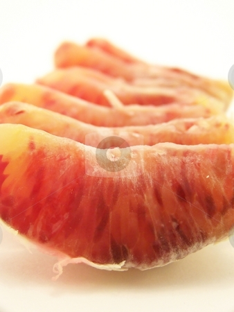 Blood Oranges stock photo, Image of a peeled blood orange, segments lined up in a row.  Vertical orientation. by Jill Oliver