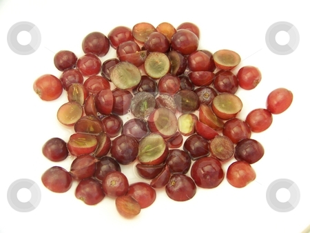 Sliced Red Grapes in Water stock photo, Image of sliced red grapes that have been placed in water, on white.  Horizontal orientation. by Jill Oliver