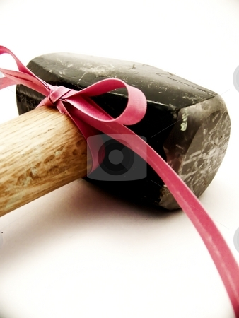 Two Pound Seldge with Pink Bow stock photo, Image of a black two pound sledge with a wooden handle laying on its side, with a thin bright pink ribbon tied in a bow and flowing to the corner of the picture. by Jill Oliver
