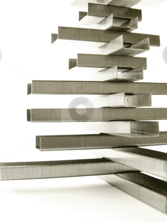 Staple Structure, Vertical Detail stock photo, Detailed image of a structure made of metal replacement staples.  White background and vertical orientation. by Jill Oliver