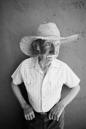 Senior Citizen Man in a Cowboy Hat stock photo, Senior Citizen Man Wearing a Straw Cowboy Hat Looks Off by Scott Griessel