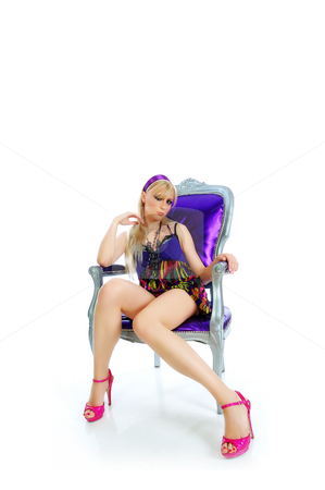 Beautiful young girl in the chair with fashionable sexy look stock photo, Beautiful young girl in the chair with fashionable sexy look by Tibor Arva