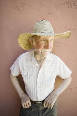 Senior Citizen Man in a Cowboy Hat stock photo, Senior Citizen Man Wearing a Straw Cowboy Hat Looks Off by Scott Griessel
