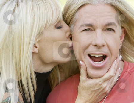 Woman kissing a man stock photo, Outdoor portrait of a woman kissing a man by Scott Griessel