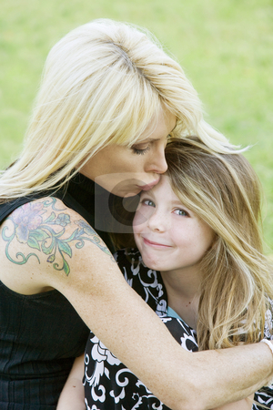Mother and Daughter stock photo, Pretty mom hugs and kisses her cute freckle-faced daughter by Scott Griessel