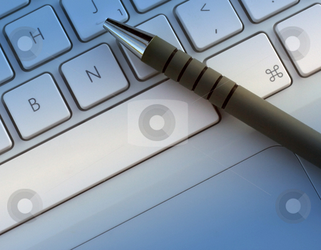 New communications stock photo, Pen resting on laptop keyboard with blue lighting effect. by Ronald Hudson