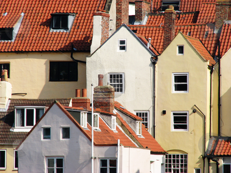 Whitby houses stock photo, Whitby houses with red tiled roofs. Whitby, North Yorkshire, UK. by Ronald Hudson
