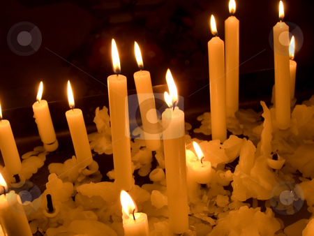 Church candles stock photo, Candles burning inside church. by Ronald Hudson