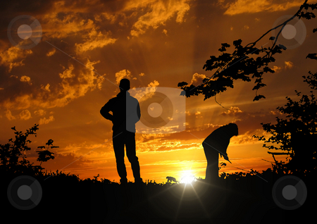 Sunset stock photo, A photography of a sunset with two people by Markus Gann