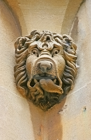 Stone head lion stock photo, A photography of an old stone head lion by Markus Gann