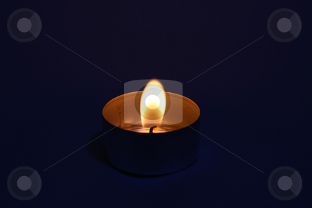 Tealight stock photo, A photography of a tealight candle with dark background by Markus Gann