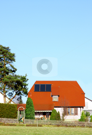 Solar panel stock photo, A Photograph of a solar panel on a private house by Markus Gann