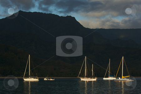 Sailboats in the Early Monring Light  stock photo, Sailboats in the Early Monring light on Hanalei Bay, Kauai, Hawaii. by Andy Dean