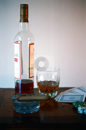 Vices stock photo, Scotch, cards, dice, and a cigar. by Rob Wright