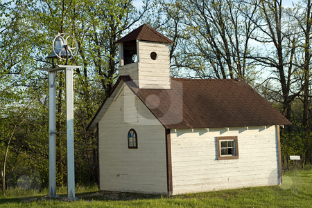 Old Schoolhouse stock photo, An old schoolhouse with a large bell outside by Richard Nelson
