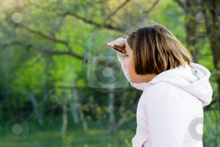 Girl Sightseeing stock photo, A young blond girl in the woods, sightseeing by Richard Nelson