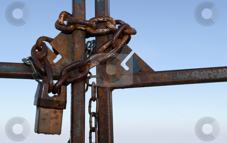 Lock and Chain stock photo, Close-up view of a gate with a metal lock and chain by Richard Nelson