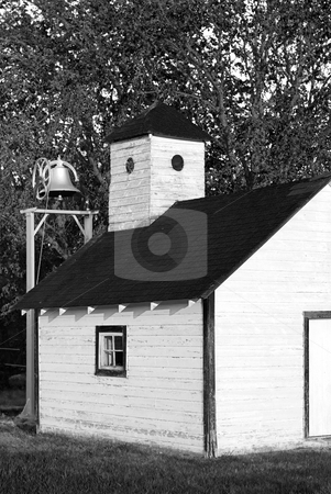 Old Schoolhouse stock photo, A black and white picture of an old schoolhouse with a bell outside by Richard Nelson